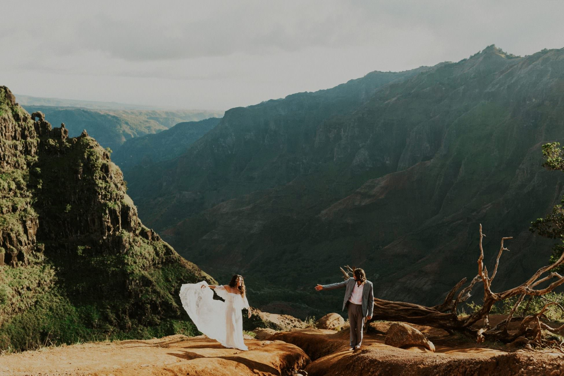 bride and groom stand at the top of Waimea Canyon by Katie Berg Photo